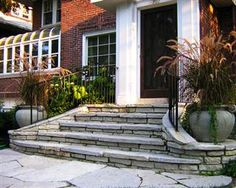 Curved front porch steps with space for flower pots- maybe a water feature?
