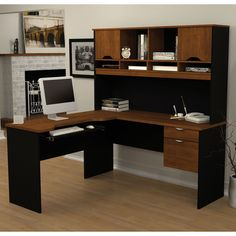 The Bestar Innova L-shaped Desk conjugates working and living with style. With multiple drawers and shelves, there are a lot of storage possibilities for an organized work environment.