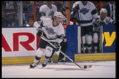 LUC ROBITAILLE:    Robitaille holds the NHL record for most points scored by a left winger, which he achieved playing for four different teams. However, he is best known for the time he spent with the L.A. Kings and still holds many of the team's franchise records..  -  100 greatest players in NHL history  -  October 11, 2016