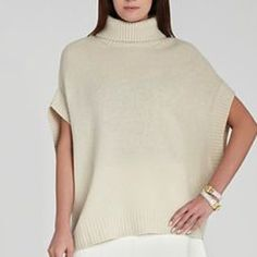 "BCBGMaxAzria Kasia Cowl Neck Oversized Sweater Hi-low knit sweater. Beige/Oatmeal color. Gently worn, Like-new condition! This boxy knit is a modern look that is as cozy as it is chic.  Turtleneck. Elbow-length dolman sleeves. Ribbed-knit trim. High-low hemline with slit at side seams. Self: Wool, Cashmere. Hand Wash. Imported. Measures approximately 31"" from shoulder to hem. This item was designed for an oversized fit. Fits true to size. XS/S BCBGMaxAzria Sweaters Cowl & Turtlenecks"