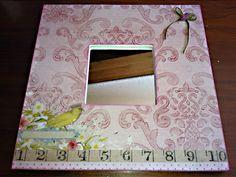 Espejo de malma decorado con papel de scrapbook, lazo y Glossit Accen para dar volumen a número y pájaro.
