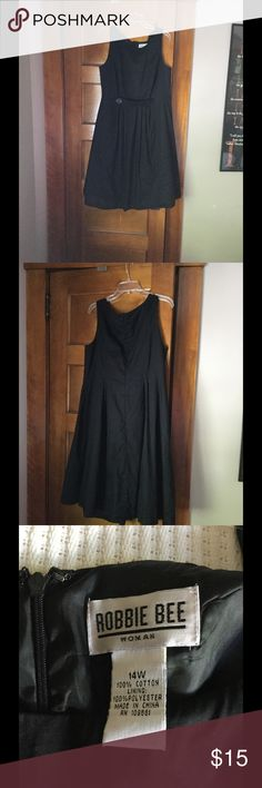 Cotton sleeveless black dress This lovely sleeveless dress is completely lined and features a back hidden zipper, boat neck styling and black button accent on the front under the bust. Very comfortable and light weight, it washes well on cold and hangs to dry. In very good used condition. Perfect for a summer wedding! Robbie Bee Dresses Midi
