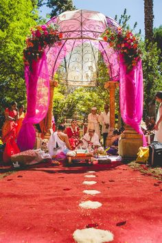 gazebo mandap decorated with flowers and fabric