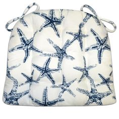 Sea Shore Starfish dining chair pads feature a sophisticated Navy Blue on white star fish print that's perfect for a serene coastal getaway or a grown-up beach cottage decor. #starfish #white