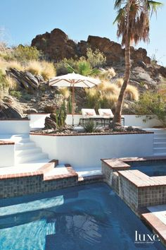 Lounge under the RH umbrella while taking in the pool and rocky desert landscape views.