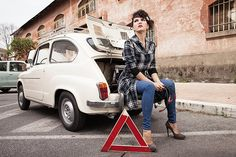 woman with broken down fiat 600 vintage rome