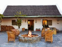 Country house with fire pit and Spanish / Texas Ranch flair - White stucco building exterior Outdoor Rooms, Outdoor Living, Outdoor Decor, Rustic Stone, Building Exterior, Outdoor Fire, Home Living, Rustic Interiors, Architecture