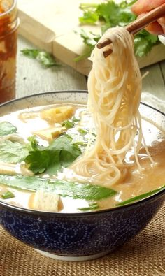 This red curry noodle soup is made with rice noodles, veggies and tofu, swimming in a spicy Thai coconut milk broth.