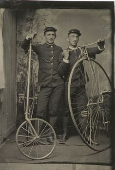 """ca. 1880's, [tintype portrait of two bicycle delivery men in uniform, posed with their high wheelers]   """"[The bicycle on the left is an] American Star safety high wheeler, which featured the smaller wheel in front in order to combat the common problem of being thrown over the handlebars following a sudden stop or unexpected bump.""""  via Cowan's Auctions"""
