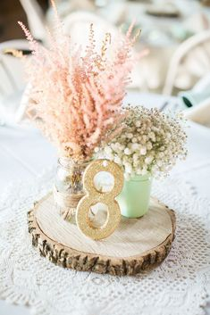 Baby's Breath and Wood Slice Centerpieces | Caynay Photo, LLC https://www.theknot.com/marketplace/caynay-photo-llc-madison-wi-819538