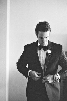 Traditional black and white groom w/ a bow tie