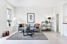 Vardagsrum kontraster orange grått