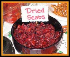 Use dried cherries or cranberries as a quick side dish for your halloween party. The sign will do the rest.