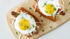 A sausage, wrapped in crispy bread, topped with an egg!
