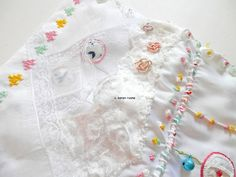 layering with handkerchiefs and cross stitch