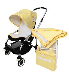 """""""DAISY"""" Full Set. A stunning and summery design, including the innovative two-in-one canopy feature. Crafted here in a yellow cotton blend and embellished with the signature Daisy flower  *Full Set: Daisy Canopy, Daisy Seatliner, Daisy Bag, Daisy Blanket.  #pramcouture #pram #pramset"""
