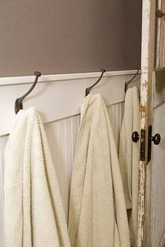 The Rigtrups: Kids Bathroom Remodel - Hooks mounted on wainscot for towels.