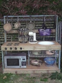 Gourmet Mud Kitchen. Love the old microwave, how fun!