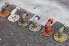 Industrial Pipe Hooks  these would be great for a bathroom wall of family towels