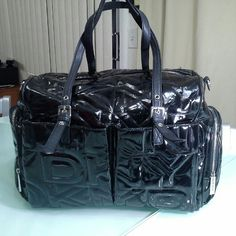 DKNY active signature bag Its stunning. DKNY embossed all over. Excellent gym bag or a big bag anywhere. Have multiple pockets a lot of space and shoulder strap along with hand straps. Ideal for traveling or week ender bag. DKNY Bags