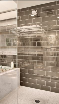 tile combination: marble slabs, tiny marble squares, high gloss contrasting subway tile