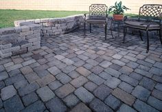 The homeowners wanted to add a patio to their backyard, without the expense of a major construction project. They determined that building a paved area with a small retaining wall in their yard, gave them the definition they wanted without the cost of adding a raised deck. Country Cobble pavers were utilized in this easy project.
