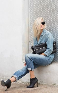 Figtny is wearing thrift jeans from Paradise Mine, clutch from Six Eleven, boyfriend denim shirt from TNA and black ankle boots
