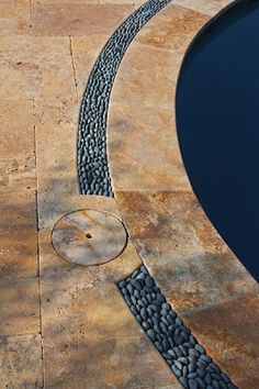Travertine patio, coping and black pebble drain. Visit the link  to see more on our facebook page and website.