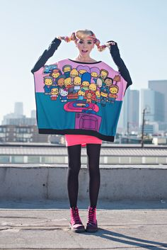 The Simpsons x Hello Kitty Collection by JapanLA Clothing: The Couch Poncho Sweater. Available at Sanrio.com, DollsKill.com, ShopJeen.com!