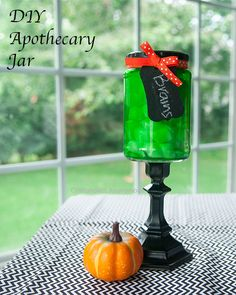 Love this apothecary jar made from a candle stick and a pickle jar! Cost only a few dollars to make. I like how she tinted the jar green for a Halloween.