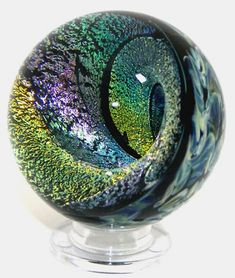 Lampwork Vortex Marble Paperweight made from borosilicate and dichroic glass. Stained Glass Lamps, Leaded Glass, Mosaic Glass, Glass Art Design, Glass Marbles, Glass Paperweights, Glass Ball, Porcelain Ceramics, Hand Blown Glass