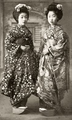 """Photo, 1910's, Japan.  """"Two Maiko (Apprentice Geisha) wearing Autumn ensembles. The girl on the left-hand side of the picture is wearing a classic combination of Sakura (cherry blossom) and Momiji (maple leaves), together with a Rangiku (spider chrysanthemum) Eri (inside collar), while the girl on the right-hand side of the picture is wearing Kiku (chrysanthemums) and Kikyou (Chinese bellflower)."""" Text and image via Blue Ruin 1 of Flickr"""