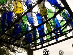This old bed spring and bottles form the top of an arbor!