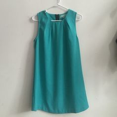"""Teal Smock Dress From an NYC boutique. Textured teal dress. Darted neckline. Exposed zipper. Has the teeniest tiniest stain, shown in third picture. It's on the right side of the dress' front about 2.5"""" from the bottom. Camilla Tree Dresses"""