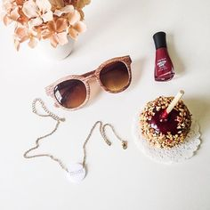 fall favorites  wooden sunglasses, mom necklace, candied apple, cherry red nail polish, hydrangeas