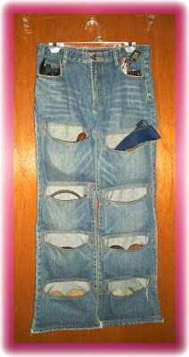 HongKongChic: Upcycled Denim Belts Organizer. I used a whole pair of jeans for this project.  I simple sewed lines across both legs to make pockets, and used the denim yellowish thread to make the pockets look prettier.  - See more at: http://hkchic.blogspot.com/2011/02/denim-belts-organizer.html#sthash.fV630A8I.dpuf