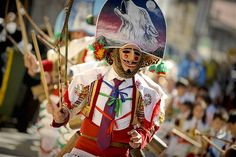 The 'Peliqueiros' (hairdressers) march during the 'Entroido' Carnival festival in Laza, Spain.