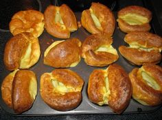 Yorkshire Pudding - the best version I've ever used. Identical to the ones I had in Sheffield. Olive oil is easily substituted for drippings, but whatever fat you use must be *smoking* hot before batter is poured in. Can use muffin tin or one large casserole.