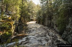 A roaring Sturgeon River through the Canyon Falls gorge. Snow is visible on the ground and trees in this May 12, 2013 picture.