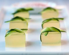 cucumber-lime margarita jello shots tied with cucumber ribbons