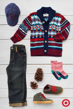 Layer on warmth with this cozy, classic Fair Isle cardigan sweater, jeans and leather boots. It's possibly the cutest look for your toddler this season.