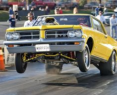 1964 Pontiac GTO wheels up Pontiac Gto, 1965 Gto, Nhra Drag Racing, Thing 1, Street Racing, Drag Cars, American Muscle Cars, Car Humor, Hot Cars