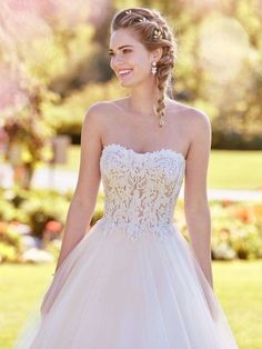 This strapless, tulle princess wedding dress features a sheer bodice accented in exposed boning and beaded lace motifs. Finished with pearl buttons over zipper closure. Lavonne is available at the Atlas Bridal Shop. Atlas Bridal Shop is a bridal & wedding dress shop in Toledo, Ohio. Wedding dress designers include Morilee, Allure Bridal, Allure Couture, Maggie Sottero, Rebecca Ingram, Sottero Midgely and more. Maggie Sottero Wedding Dresses, 2016 Wedding Dresses, Wedding Dress Shopping, Wedding Dress Styles, Designer Wedding Dresses, Bridal Dresses, Wedding Gowns, Flower Girl Dresses, Wedding Hair