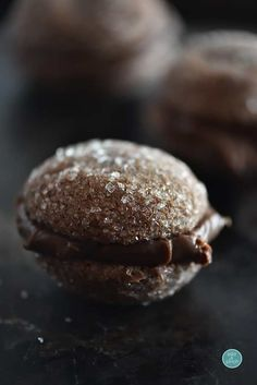 Chocolate Ganache Cookies Recipe - Decadent cookie with dark ganache filling, rich chocolate cookie with beautiful sugar crystals! So elegant and delicious!  from addapinch.com