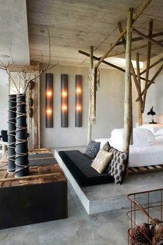 Letto tronchi albero - love those bed posts.