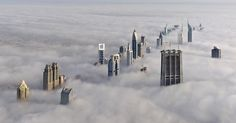 Dubai skyline in the fog. Could you imagine being on one of those floors above the fog?!