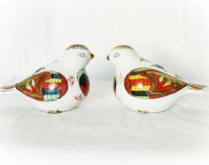 Vintage pair of hand-made, hand-painted bird figurines, approximate era 1960s, featuring Russian bohemian matroyska painting style patterns.