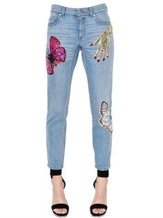 ALEXANDER MCQUEEN Surreal Embellished Cotton Denim Jeans, Blue. #alexandermcqueen #cloth #jeans