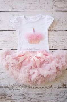 Super Fluffy and Soft pettiskirt. Matching bubble sleeve top with cupcake candle flower embellishment. Ready for your peanut to wear to her first