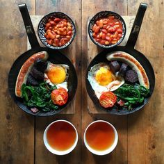 @symmetrybreakfast • Sunday: A twist on a classic! Fresh blood black pudding, sausage, spinach cooked in guanciale, multiple beans in tomato sauce, grilled heritage tomato, free range fried egg and a cup of perfect tea
